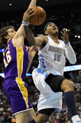 DENVER - APRIL 08:  Carmelo Anthony #15 of the Denver Nuggets lays up a shot as Pau Gasol #16 of the Los Angeles Lakers defends during NBA action at the Pepsi Center on April 8, 2010 in Denver, Colorado. The Nuggets defeated the Lakers 98-96. NOTE TO USER