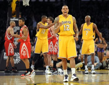 LOS ANGELES, CA - JANUARY 05:  Shannon Brown #12 of the Los Angeles Lakers celebrates a basket over theHouston Rockets on way to a 88-79 win during the game at Staples Center on January 5, 2010 in Los Angeles, California.  NOTE TO USER: User expressly ack