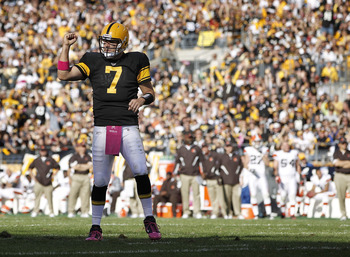 PITTSBURGH - OCTOBER 17:  Ben Roethlisberger #7 of the Pittsburgh Steelers reacts after throwing a fourth quarter touchdown pass while playing the Cleveland Browns on October 17, 2010 at Heinz Field in Pittsburgh, Pennsylvania. Pittsburgh won the game 28-