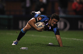 STOCKPORT, ENGLAND - OCTOBER 08:  Tom Brady of Sale Sharks dives over the line to score his second try during the Amlin Challenge Cup match between Sale Sharks and Cetransa El Salvador at Edgeley Park on October 8, 2010 in Stockport, England.  (Photo by A