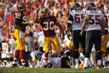 LANDOVER, MD - SEPTEMBER 19:  LaRon Landry #30 of the Washington Redskins celebrates a sack of Matt Schaub #8 of the Houston Texans at FedExField on September 19, 2010 in Landover, Maryland. The Redskins lead the Texans at the half 20-7. (Photo by Larry F