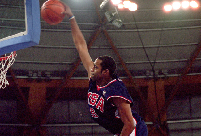 25 Sep 2000:  Vince Carter of the USA leaps over Frederic Weis of France to dunk during the Mens Basketball Preliminaries at the Dome in the Olympic Park on Day 10 of the Sydney 2000 Olympic Games in Sydney, Australia. \ Mandatory Credit: Darren McNamara/