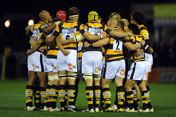 STOCKPORT, ENGLAND - OCTOBER 01:  London Wasps huddle together prior to the AVIVA Premiership match between Sale Sharks and London Wasps at Edgeley Park on October 1, 2010 in Stockport, England.  (Photo by Chris Brunskill/Getty Images)