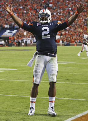 AUBURN - OCTOBER 16:  Quarterback Cam Newton #2 of the Auburn Tigers celebrates during the game against the Arkansas Razorbacks at Jordan-Hare Stadium on October 16, 2010 in Auburn, Alabama.  The Tigers beat the Razorbacks 65-43.  (Photo by Mike Zarrilli/