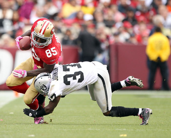 SAN FRANCISCO - OCTOBER 17:  Vernon Davis #85 of the San Francisco 49ers is tackled by Chris Johnson #37 of the Oakland Raiders at Candlestick Park on October 17, 2010 in San Francisco, California.  (Photo by Ezra Shaw/Getty Images)