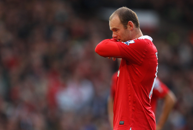 MANCHESTER, ENGLAND - OCTOBER 16:  Wayne Rooney of Manchester United looks dejected during the Barclays Premier League match between Manchester United and West Bromwich Albion at Old Trafford on October 16, 2010 in Manchester, England.  (Photo by Alex Liv