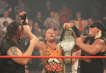 "RVD celebrates after becoming the World Heavyweight Champion with ""they"" members; Hulk Hogan and Abyss"