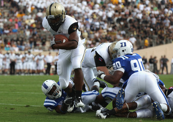 DURHAM, NC - SEPTEMBER 25:  Brian Cobbs #32 of the Army Black Knights runs for a touchdown against the Duke Blue Devils at Wallace Wade Stadium on September 25, 2010 in Durham, North Carolina.  (Photo by Streeter Lecka/Getty Images)