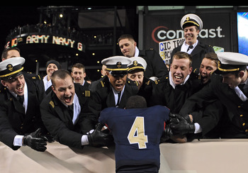 PHILADELPHIA - DECEMBER 12: Quarterback Ricky Dobbs #4 of the Navy Midshipmen, and game MVP, jumps into the crowd after their 17-3 victory over the Army Black Knights on December 12, 2009 at Lincoln Financial Field in Philadelphia, Pennsylvania. (Photo by