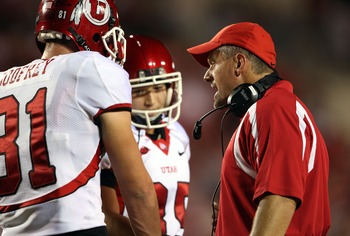 LOUISVILLE, KY - OCTOBER 05:  Head coach Kyle Whittingham of the Utah Utes talks with two of his players during action against the Louisville Cardinal during the game on October 5, 2007 at Papa John's Cardinal Stadium in Louisville, Kentucky.  (Photo by A