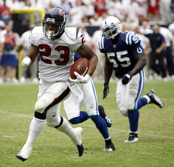 HOUSTON - SEPTEMBER 12:  Running back Arian Foster #23 of the Houston Texans rushes past defensive back Antoine Bethea #41 of the Indianapolis Colts during the NFL season opener at Reliant Stadium on September 12, 2010 in Houston, Texas.  (Photo by Bob Le