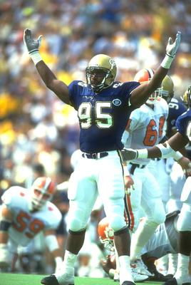 13 Oct 1990: GEORGIA TECH DEFENSIVE LINEMAN MARCO COLEMAN CELEBRATES DURING THE YELLOW JACKETS 21-19 WIN OVER THE CLEMSON TIGERS AT THE GRANT FIELD IN ATLANTA, GEORGIA