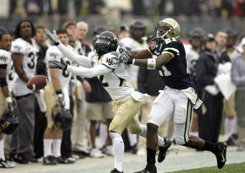 JACKSONVILLE, FL - DECEMBER 2:  Alphonso Smith #2 of the Wake Forest Demon Deacons moves for the reception against Calvin Johnson #21 of the Georgia Tech Yellow Jackets during the Atlantic Coast Conference Championship at Alltel Stadium on December 2, 200