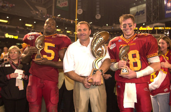 28 Dec 2000:  (L-R) Reggie Haywood #15, head coach Dan McCarney and Sage Rosenfels #18 of Iowa State pose with the trophies in celebration of their 37-29 victory over Pittsburgh during the Insight.com Bowl at Bank One Ballpark in Phoenix, Arizona.  DIGITA