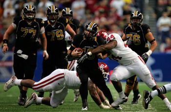 SAN ANTONIO - DECEMBER 1:  Quarterback Chase Daniel #10 of the Missouri Tigers is tackled by Jeremy Beal #44 of the Oklahoma Sooners during the Big 12 Championship at the Alamodome December 1, 2007 in San Antonio, Texas.  (Photo by Ronald Martinez/Getty I