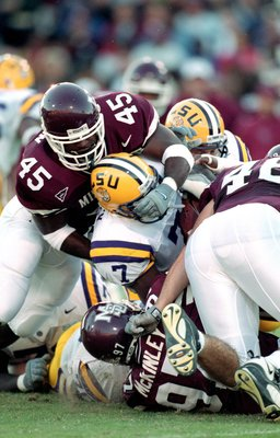 23 Oct 1999:  Barrin Simpson #45 of the Mississippi State Bulldogs tackles the Rodney Meanley #7 of the LSU Tigers at the Scott Stadium in Starkville, Mississippi. The Bulldogs defeated the Tigers 17-16. Mandatory Credit: Scott Halleran  /Allsport
