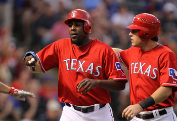 ARLINGTON, TX - MAY 17:  (L-R) Vladimir Guerrero #27 and Ian Kinsler #5 of the Texas Rangers celebrate after scoring against the Los Angeles Angels of Anaheim on May 17, 2010 at Rangers Ballpark in Arlington, Texas.  (Photo by Ronald Martinez/Getty Images