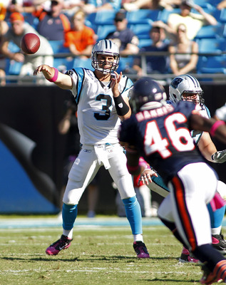 CHARLOTTE, NC - OCTOBER 10: Quarterback Matt Moore #3 of the Carolina Panthers throws the ball as safety Chris Harris #46 of the Chicago Bears defends at Bank of America Stadium on October 10, 2010 in Charlotte, North Carolina.  (Photo by Geoff Burke/Gett