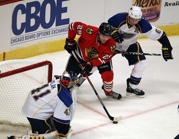 CHICAGO - OCTOBER 18: Bryan Bickell #29 of the Chicago Blackhawks moves to shoot at Jaroslav Halak #41 of the St. Louis Blues under defensive pressure from Erik Johnson #6 at the United Center on October 18, 2010 in Chicago, Illinois. (Photo by Jonathan D