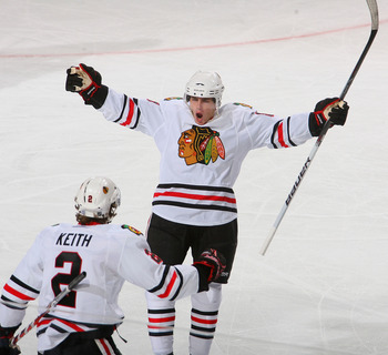 BUFFALO, NY - OCTOBER 11: Patrick Kane #88 and Duncan Keith #2 of the Chicago Blackhawks celebrate Kane's goal in the first period against the Buffalo Sabres  at HSBC Arena on October 11, 2010 in Buffalo, New York.  (Photo by Rick Stewart/Getty Images)