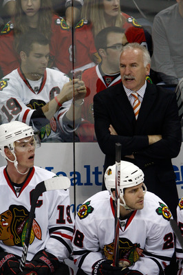 COLUMBUS,OH - October 15:  Head Coach Joel Quenneville of the Chicago Blackhawks gives instructions to his players during the third period of their game against the Columbus Blue Jackets on October 15, 2010 at Nationwide Arena in Columbus, Ohio.  Chicago