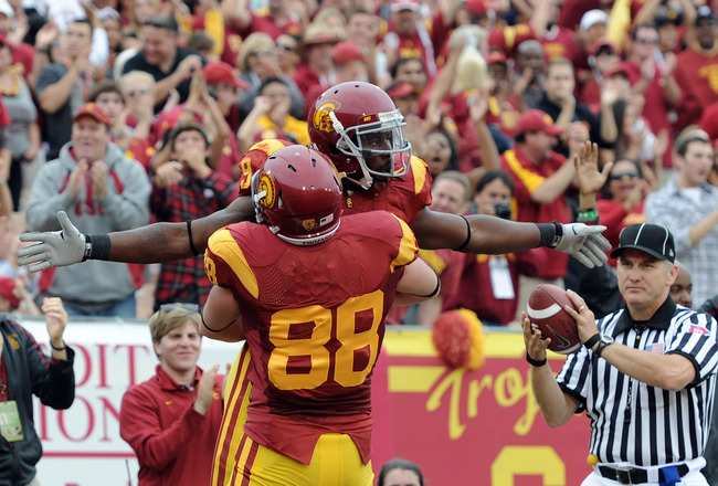 LOS ANGELES, CA - OCTOBER 16:  David Ausberry #9 of the USC Trojans celebrates his touchdwon with Blake Ayles #88 for a 14-0 lead over the California Golden Bears during the first quarter at Los Angeles Memorial Coliseum on October 16, 2010 in Los Angeles