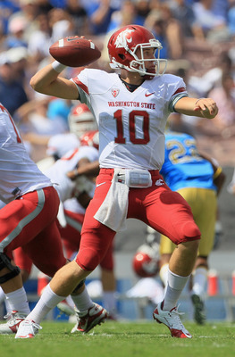 PASADENA, CA - OCTOBER 02:  Quarterback Jeff Tuel #10 of the Washington State Cougars drops back to pass against the UCLA Bruins during the first quarter at the Rose Bowl on October 2, 2010 in Pasadena, California.  (Photo by Jeff Gross/Getty Images)