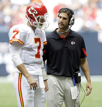 HOUSTON - OCTOBER 17:  Quarterback Matt Cassel #7 of the Kasnas City Chiefs talks with quarterback coach Nick Sirianni during a game against the Houston Texans at Reliant Stadium on October 17, 2010 in Houston, Texas.  (Photo by Bob Levey/Getty Images)