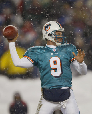 FOXBORO, MA - DECEMBER 7:  Quarterback Jay Fiedler #9 of the Miami Dolphins passses the ball against the New England Patriots during the game at Gillette Stadium on December 7, 2003 in Foxboro, Massachusetts. The Patriots defeated the Dolphins 16-0.  (Pho