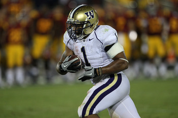 LOS ANGELES - OCTOBER 2:  Running back Chris Polk  of the Washington Huskies carries the ball against the USC Trojans at the Los Angeles Memorial Coliseum on October 2, 2010 in Los Angeles, California.  Washington won 32-31.   (Photo by Stephen Dunn/Getty