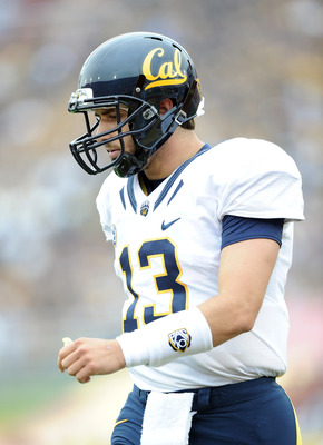 LOS ANGELES, CA - OCTOBER 16:  Kevin Riley #13 of the California Golden Bears returns to the field  against the USC Trojans at Los Angeles Memorial Coliseum on October 16, 2010 in Los Angeles, California.  (Photo by Harry How/Getty Images)