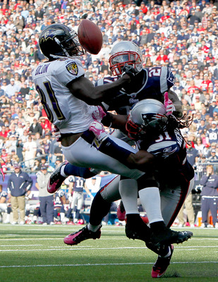 FOXBORO, MA - OCTOBER 17:  Anquan Boldin #81 of the Baltimore Ravens is unable catch the football under the pressure of Brandon Meriweather #31 and Kyle Arrington #27 of the New England Patriots in the second half at Gillette Stadium on October 17, 2010 i
