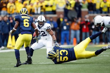 ANN ARBOR, MI - OCTOBER 24:  Evan Royster #22 of the Penn State Nittany Lions carries the ball against Donovan Warren #6 and Ryan Van Bergen #53 of the Michigan Wolverines on October 24, 2009 at Michigan Stadium in Ann Arbor, Michigan. (Photo by  Gregory