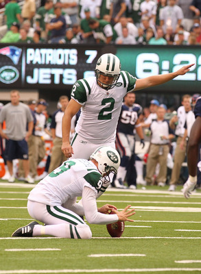 EAST RUTHERFORD, NJ - SEPTEMBER 19:  Nick Folk #2 of the New York Jets kicks a field goal as Steve Weatherford #9 holds the ball against the New England Patriots during their  game on September 19, 2010 at the New Meadowlands Stadium  in East Rutherford,