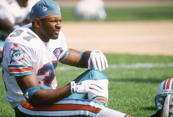 11 Sep 1994:  Cornerback J.B. Brown of the Miami Dolphins stretches out before a game against the Green Bay Packers at Milwaukee County Stadium in Milwaukee, Wisconsin.  The Dolphins won the game 24-14. Mandatory Credit: Jonathan Daniel  /Allsport