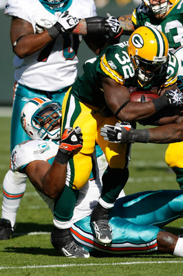 GREEN BAY, WI - OCTOBER 17: Brandon Jackson #32 of the Green Bay Packers runs against the Miami Dolphins at Lambeau Field on October 17, 2010 in Green Bay, Wisconsin. The Dolphins defeated the Packers 23-20 in overtime. (Photo by Scott Boehm/Getty Images)