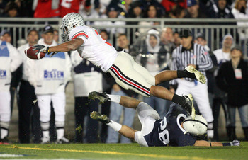 STATE COLLEGE, PA - NOVEMBER 7: Running back Brandon Saine #3 of the Ohio State Buckeyes dives for the end zone and scores a 6 yard touchdown during a game against the Penn State Nittany Lions on November 7, 2009 at Beaver Stadium in State College, Pennsy