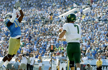 Akeem Ayers leaps for a goal-line pick six in UCLA's last game against Oregon