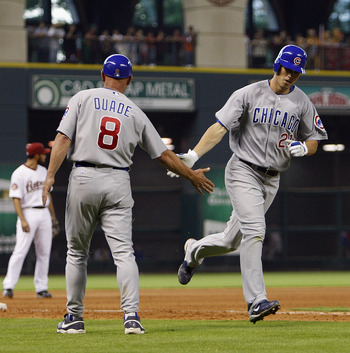 HOUSTON - JUNE 05:  Tyler Colvin #21 of the Chicago Cubs is congratulated by third base coach Mike Quade after hitting a home run against the Houston Astros at Minute Maid Park on June 5, 2010 in Houston, Texas.  (Photo by Bob Levey/Getty Images)