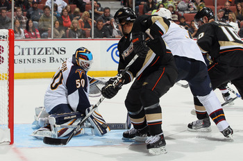 ANAHEIM, CA - OCTOBER 15:  Goaltender Chris Mason #50 of the Atlanta Thrashers makes a save on a shot by Teemu Selanne #8 of the Anaheim Ducks in the first period at Honda Center on October 15, 2010 in Anaheim, California.  (Photo by Jeff Gross/Getty Imag