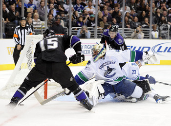 LOS ANGELES, CA - OCTOBER 15:  Roberto Luongo #1 of the Vancouver Canucks makes a save on Brad Richardson #15 of the Los Angeles Kings during the second period at the Staples Center on October 15, 2010 in Los Angeles, California.  (Photo by Harry How/Gett