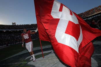 DALLAS - OCTOBER 02:  Defensive tackle Adrian Taylor #86 of the Oklahoma Sooners holds a flag while celebrating a28-20 win against the Texas Longhorns at the Cotton Bowl on October 2, 2010 in Dallas, Texas.  (Photo by Ronald Martinez/Getty Images)