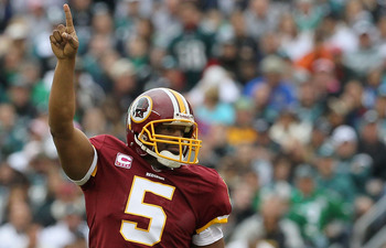 PHILADELPHIA - OCTOBER 03:  Donovan McNabb #5 of the Washington Redskins celebrates after throwing a first quater touchdown pass against the Philadelphia Eagles on October 3, 2010 at Lincoln Financial Field in Philadelphia, Pennsylvania.  (Photo by Jim Mc