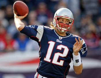 FOXBORO, MA - OCTOBER 17:  Tom Brady #12 of the New England Patriots throws during a game against the Baltimore Ravens at Gillette Stadium on October 17, 2010 in Foxboro, Massachusetts. (Photo by Jim Rogash/Getty Images)