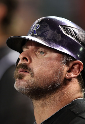 PHOENIX - SEPTEMBER 21:  Jason Giambi #23 of the Colorado Rockies looks on from the dugout during the Major League Baseball game against the Arizona Diamondbacks at Chase Field on September 21, 2010 in Phoenix, Arizona.  (Photo by Christian Petersen/Getty