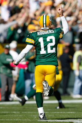GREEN BAY, WI - OCTOBER 17: Aaron Rogers #12 of the Green Bay Packers celebrates a touchdown pass against the Miami Dolphins at Lambeau Field on October 17, 2010 in Green Bay, Wisconsin. (Photo by Scott Boehm/Getty Images)