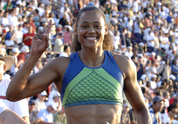 Marion Jones wins the women's 100-meter dash June 23 at the 2006 AT&T Outdoor Track and Field Championships in Indianapolis. (Photo by A. Messerschmidt/Getty Images)