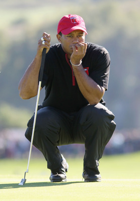 NEWPORT, WALES - OCTOBER 04:  Tiger Woods of the USA lines up a putt in the singles matches during the 2010 Ryder Cup at the Celtic Manor Resort on October 4, 2010 in Newport, Wales.  (Photo by Jamie Squire/Getty Images)