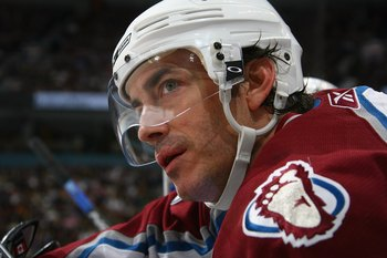 VANCOUVER, BC - APRIL 5:  Joe Sakic #19 of the Colorado Avalanche looks on against the Vancouver Canucks at General Motors Place on April 5, 2007 in Vancouver, British Columbia, Canada. The Avalanche won 3-1. (Photo by Jeff Vinnick/Getty Images)