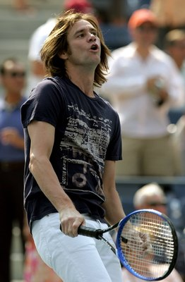 NEW YORK - SEPTEMBER 09:  Actor Jim Carrey hits balls to fans before Andy Roddick takes on Mikhail Youzhny of Russia in the men's semi-final at the U.S. Open at the USTA Billie Jean King National Tennis Center in Flushing Meadows Corona Park on September